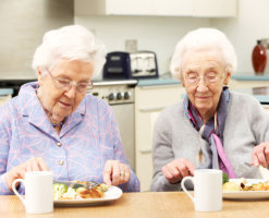 Elderly women having breakfast