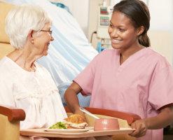 Serving food to elderly patient